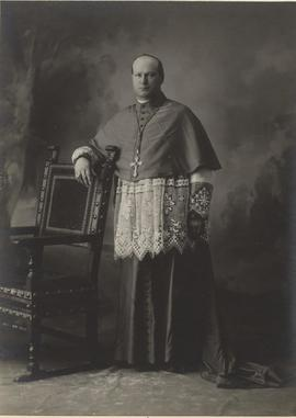 Official portrait of Most Rev. John Thomas McNally, first Bishop of Calgary, standing